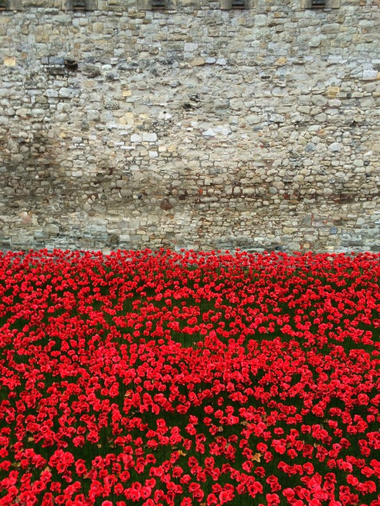 I love the red against the ancient tower walls