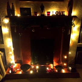 Christmas lights seem to have turned the fireplace in my front room into a terrifying pagan altar - maybe that's the true meaning of Christmas?